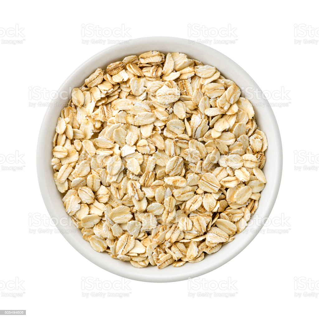 Organic Rolled Oats in a ceramic bowl stock photo
