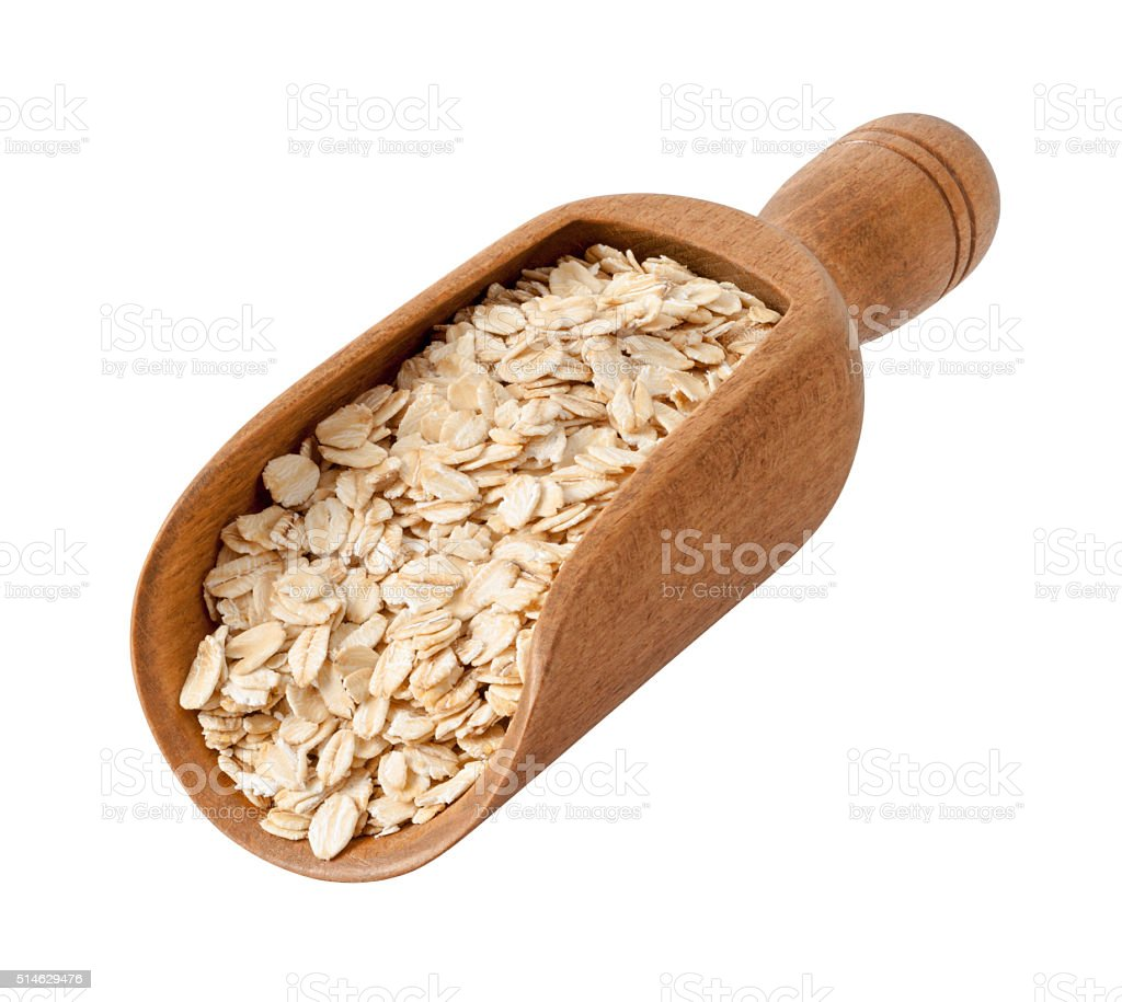 Organic Rolled Oats in a Wood Scoop stock photo
