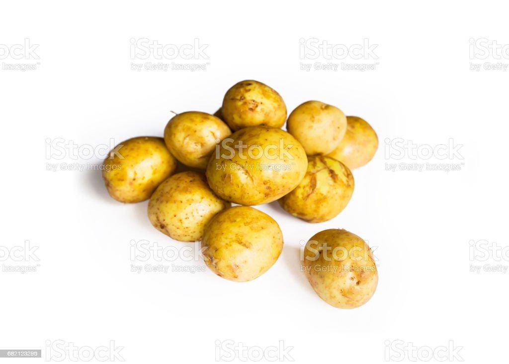 Organic round potatoes on a white background stock photo