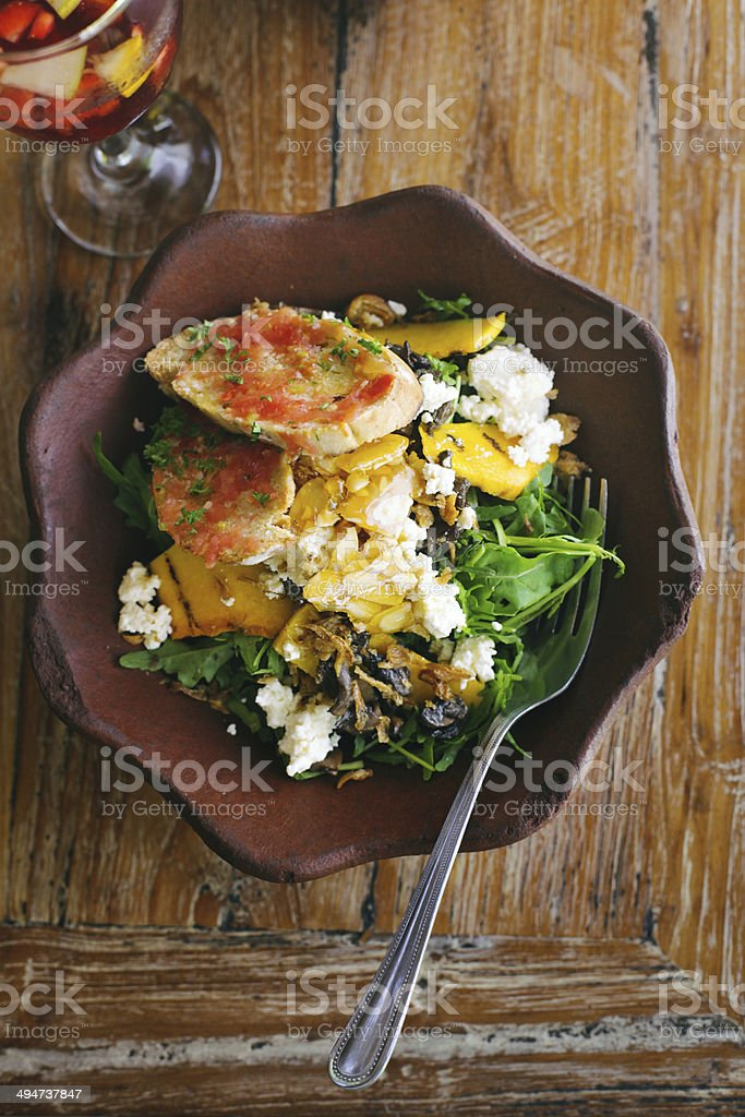 Organic salad with sangria beverage royalty-free stock photo