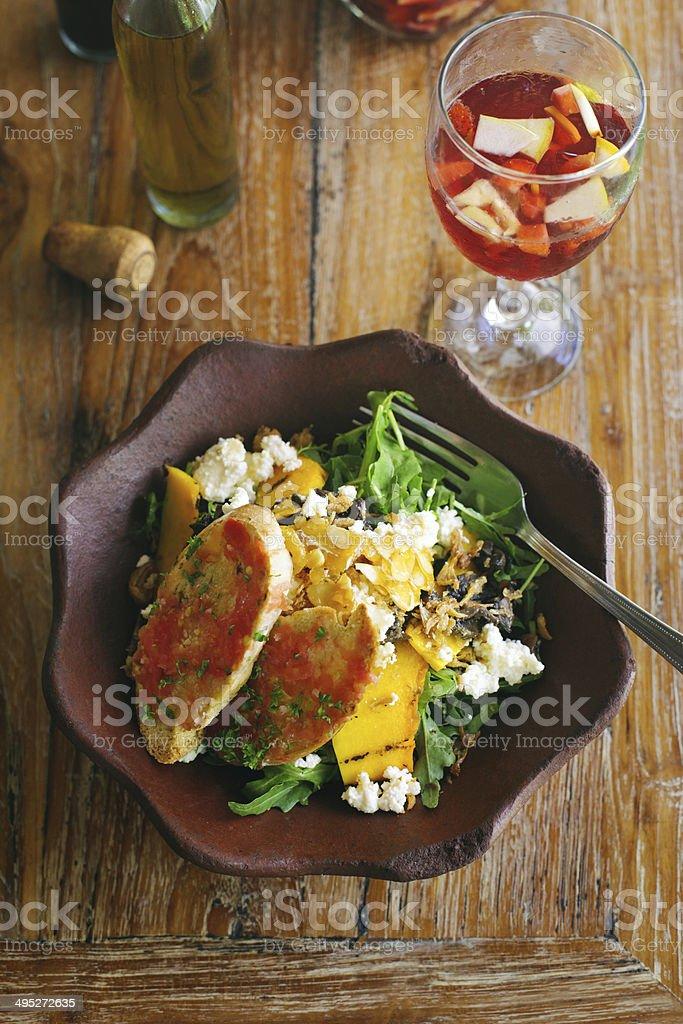 Organic salad with sangria beverage royalty-free stock photo