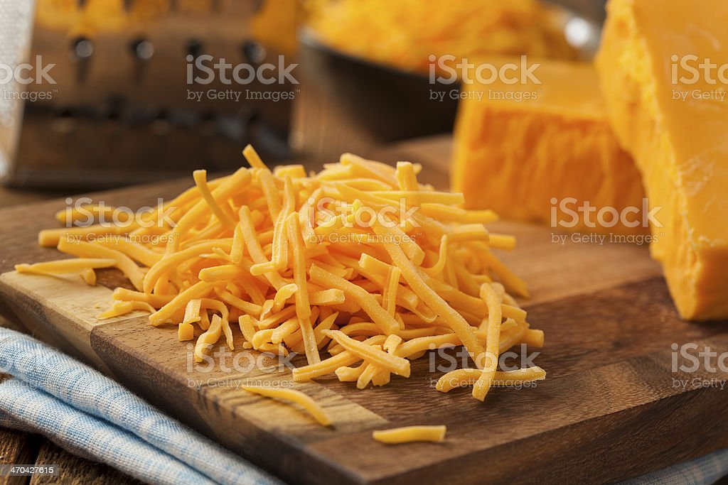 Organic Shredded Sharp Cheddar Cheese stock photo