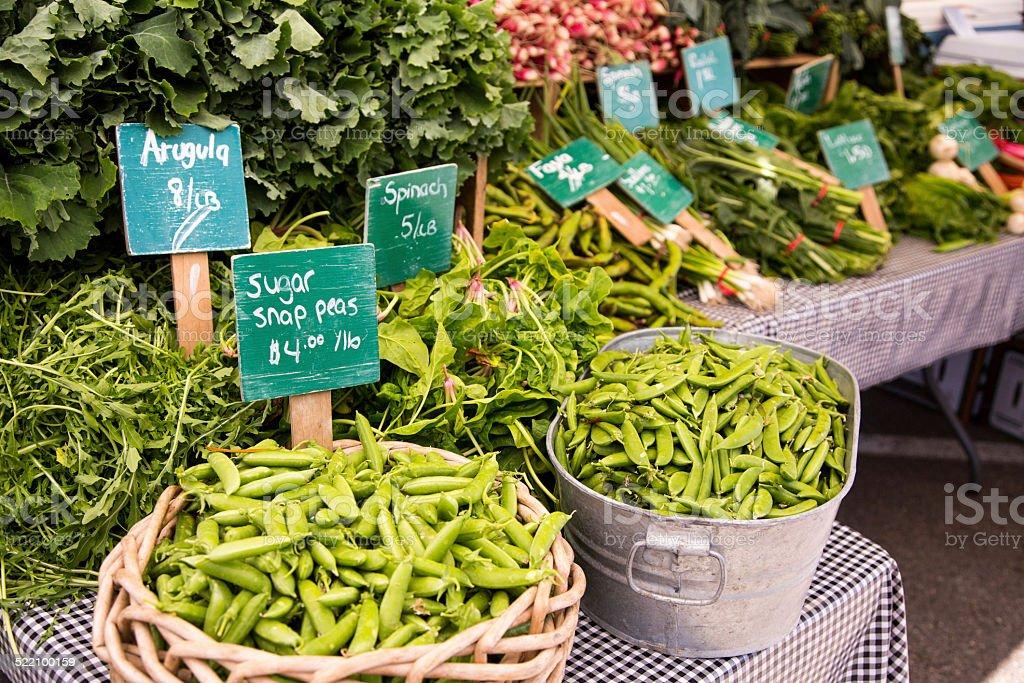 Organic Snap Peas, Arugula and Spinach Farmer Market stock photo