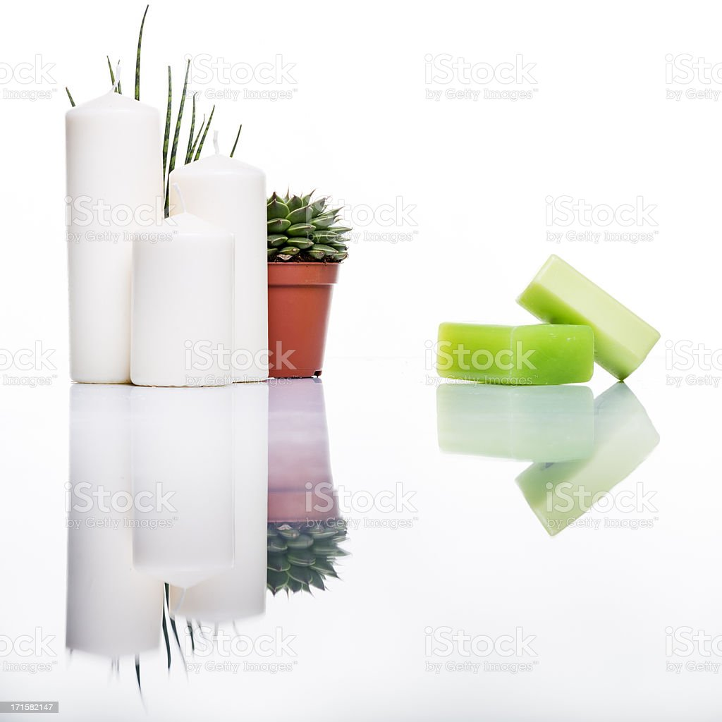 Organic soap and candles studio shot on white with reflection royalty-free stock photo