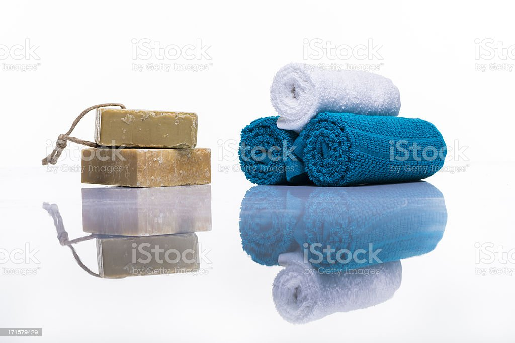 Organic soap and towels studio shot on white with reflection royalty-free stock photo