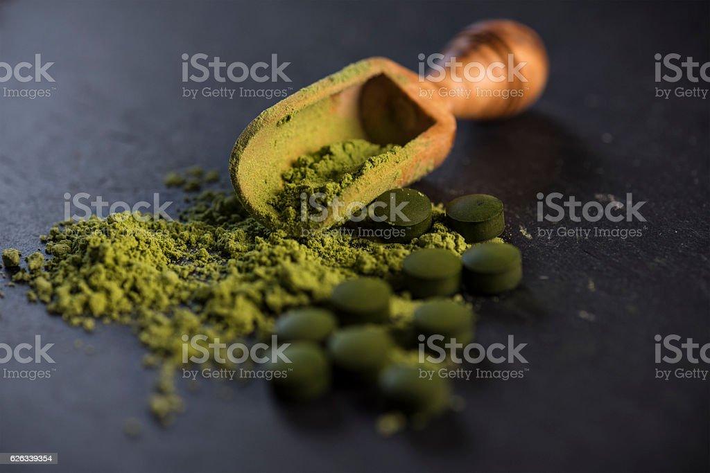 Organic Spirulina Powder and Tablets stock photo
