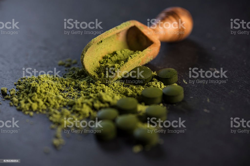 Organic Spirulina Powder and Tablets stock photo
