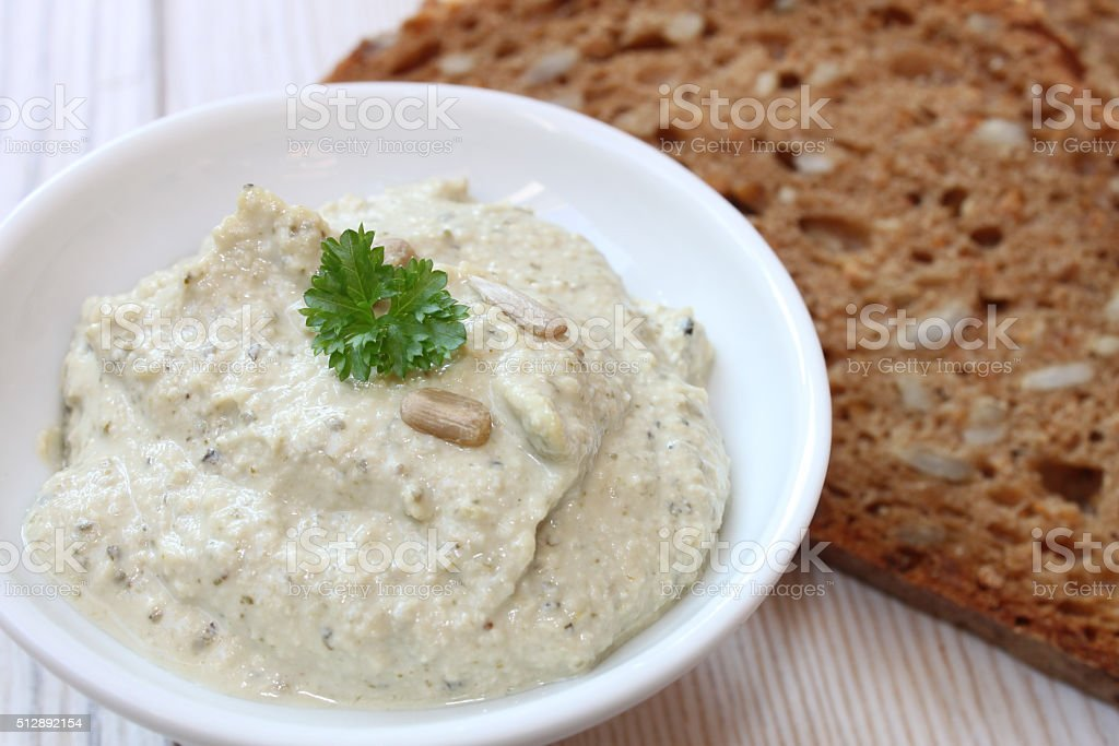 organic spread with herbs and seeds and grain bread stock photo