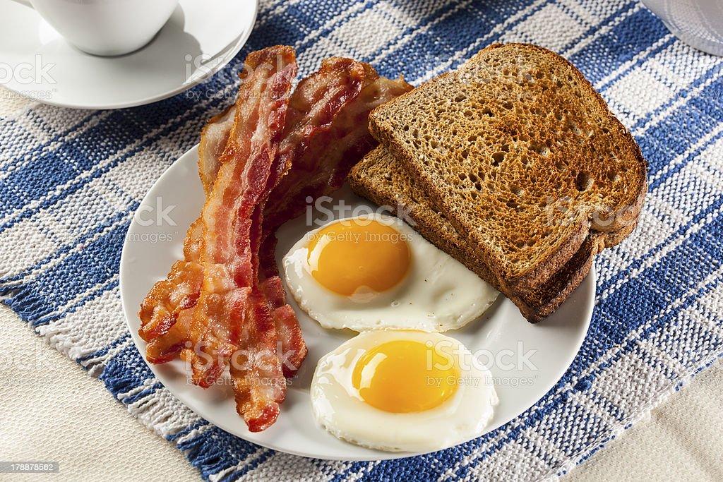 Organic Sunnyside up Egg with toast and bacon stock photo