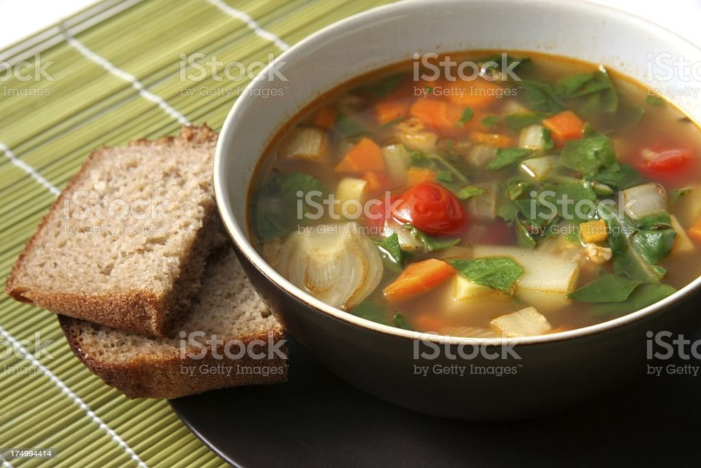 Organic Vegetable minestrone with brown bread stock photo