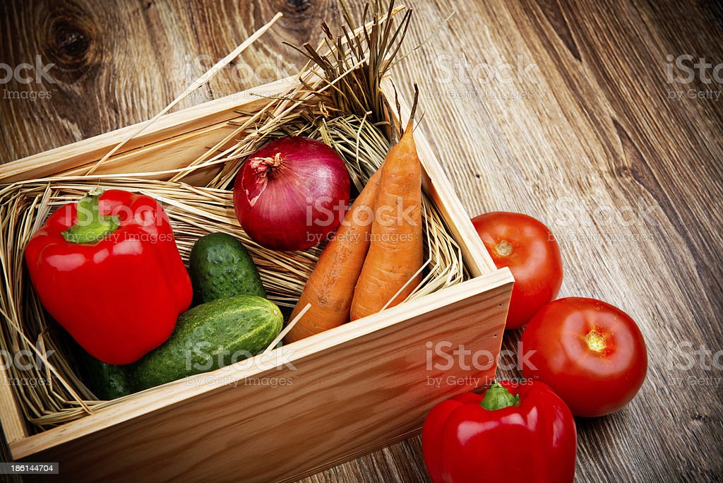 Organic vegetables in a box on top of a table royalty-free stock photo