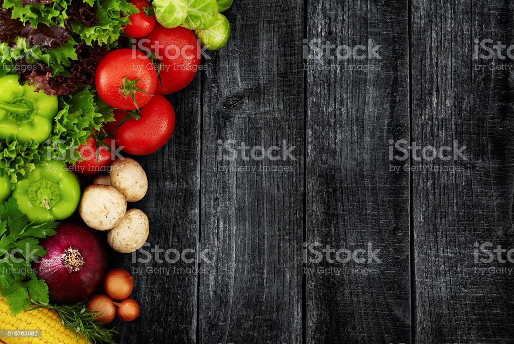 Organic Vegetables on a Black Wooden Background stock photo