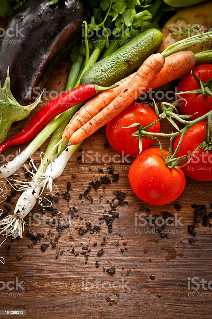 Organic vegetables on a wood table royalty-free stock photo