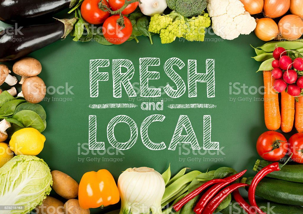 organic vegetables on the fresh and local sign stock photo