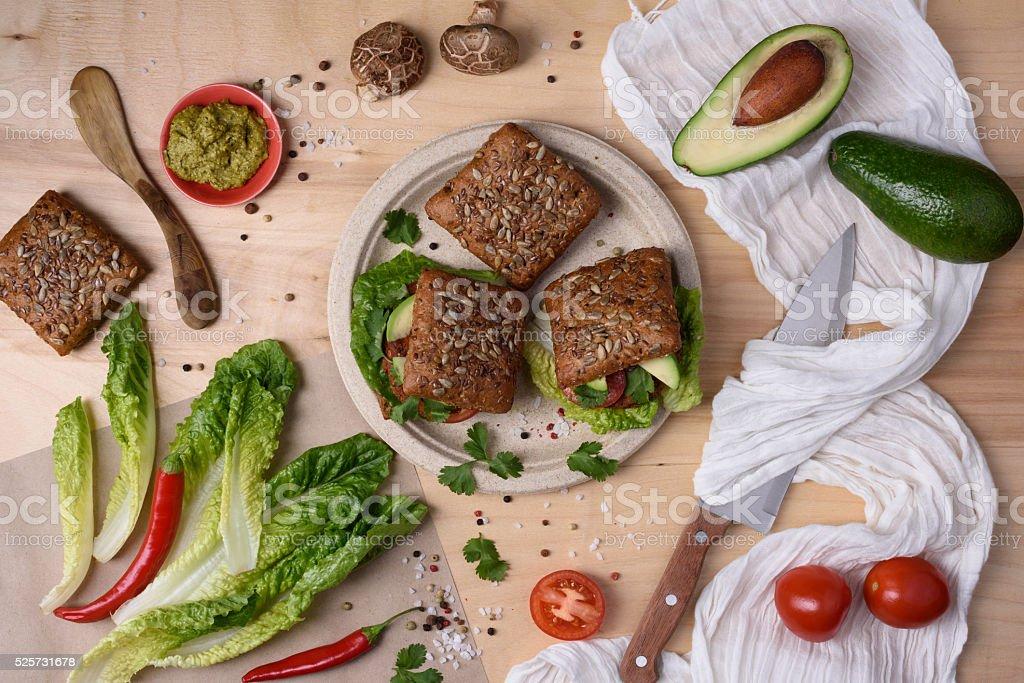 Organic vegetarian burgers on wooden table. stock photo