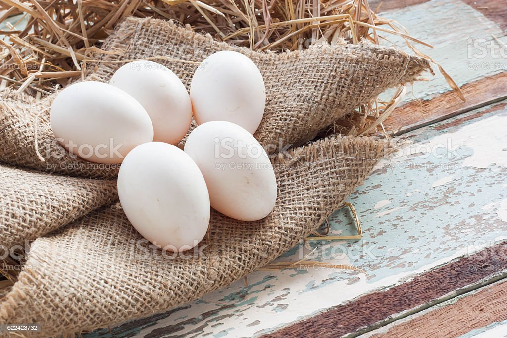 Organic white eggs on vintage wooden background. stock photo