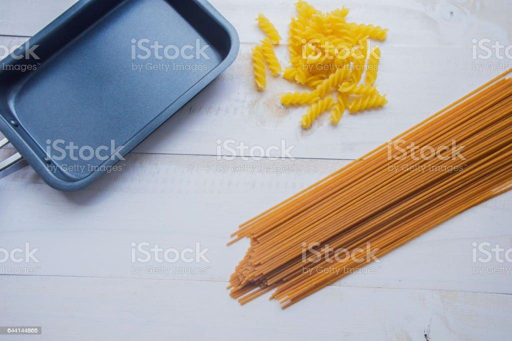 Organic whole wheat bunch of raw italian spaghetti pasta. stock photo