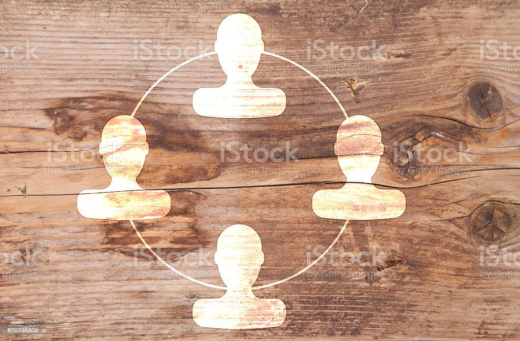 Organigram with heads on wooden background stock photo
