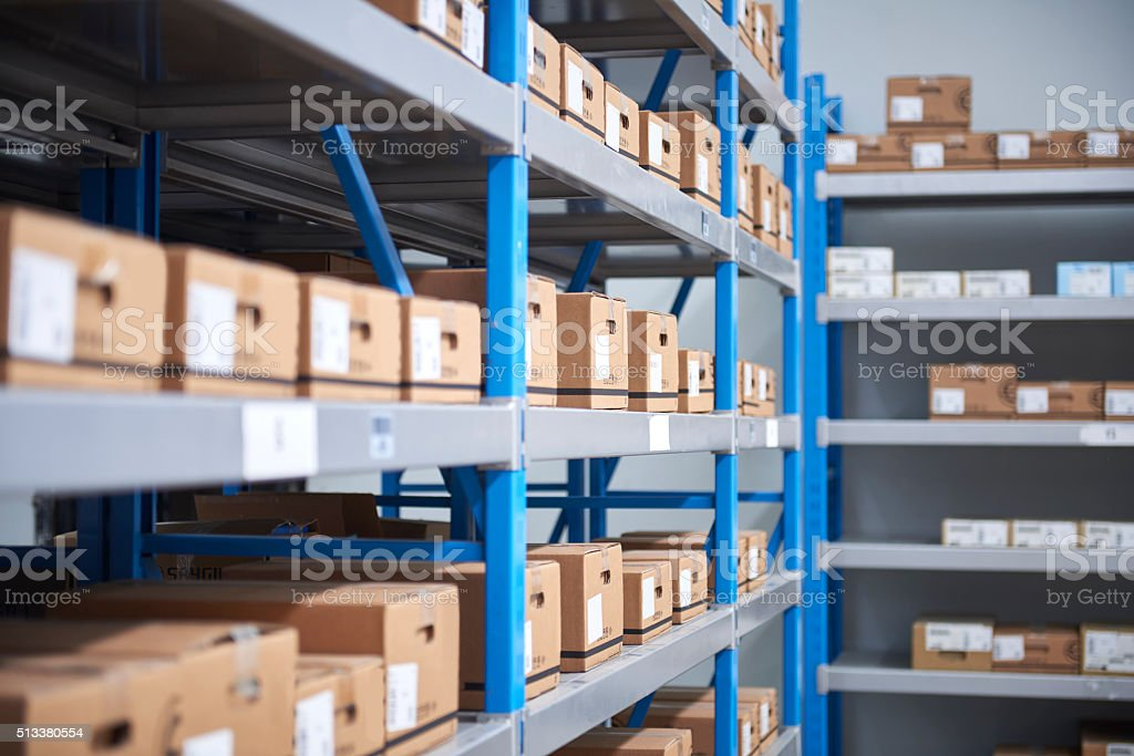 Organised cardboad boxes on shelfes stock photo