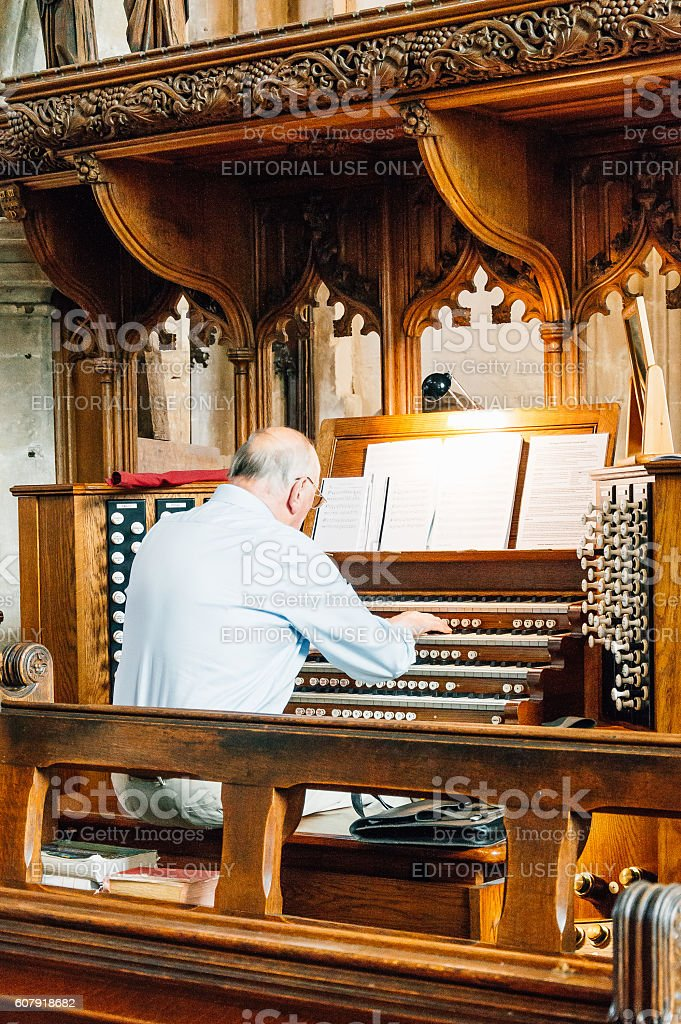 Organist playing at the church stock photo