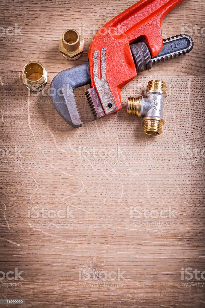 Organized Copysoace Monkey Wrench And Brass Pipe Connectors On W stock photo