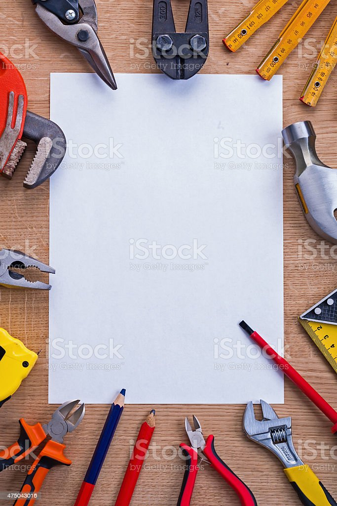 organized copyspace white shhet of paper and cutter meter hammer stock photo