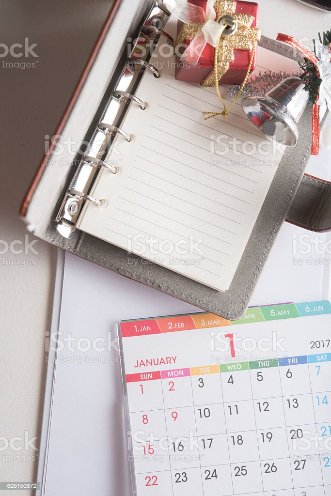 organizer book with blank page with calendar and holiday decorat stock photo
