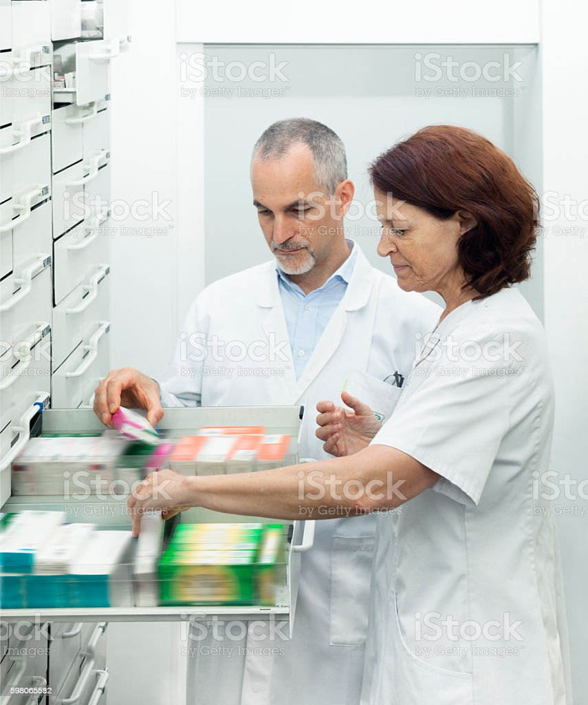 Organizing medicines at the pharmacy stock photo