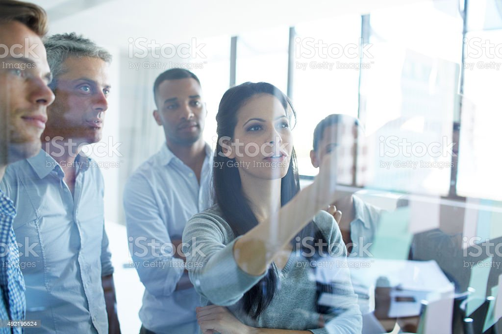 Organizing priorities for their project stock photo
