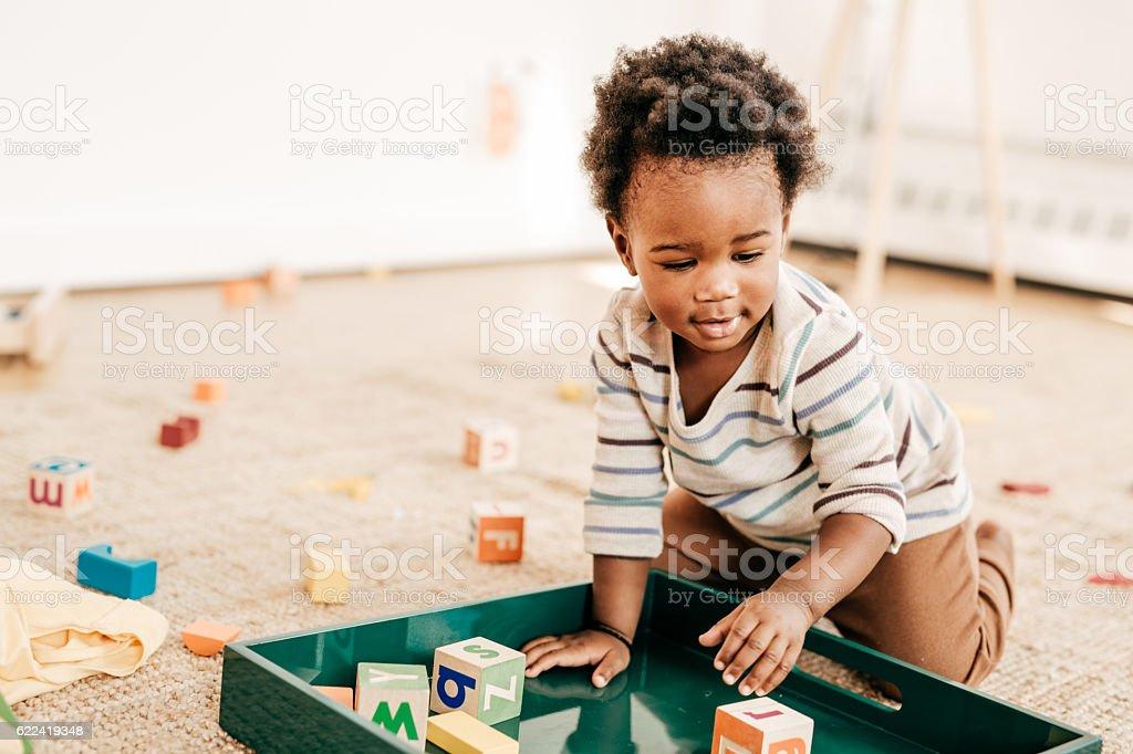 Organizing toddlers toys stock photo