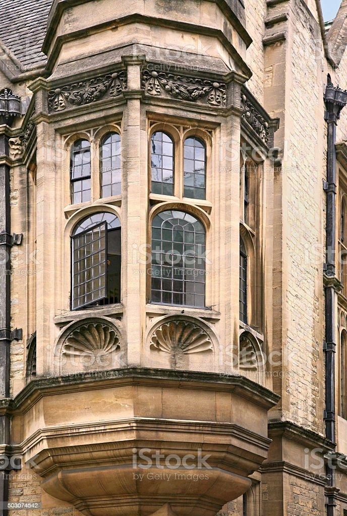 oriel window of gothic stone college building stock photo