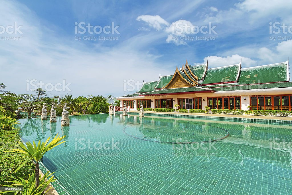 Oriental architecture reflected in the pool royalty-free stock photo