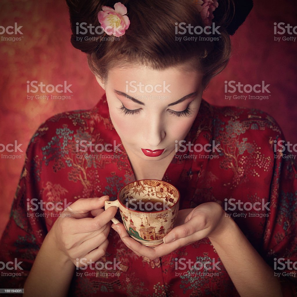 oriental beauty holding a cup of tea royalty-free stock photo