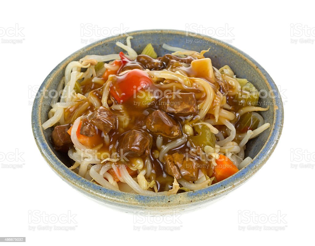 Oriental beef and vegetable meal in bowl stock photo