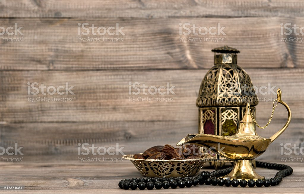 Oriental lamp, lantern, rosary dates still life stock photo