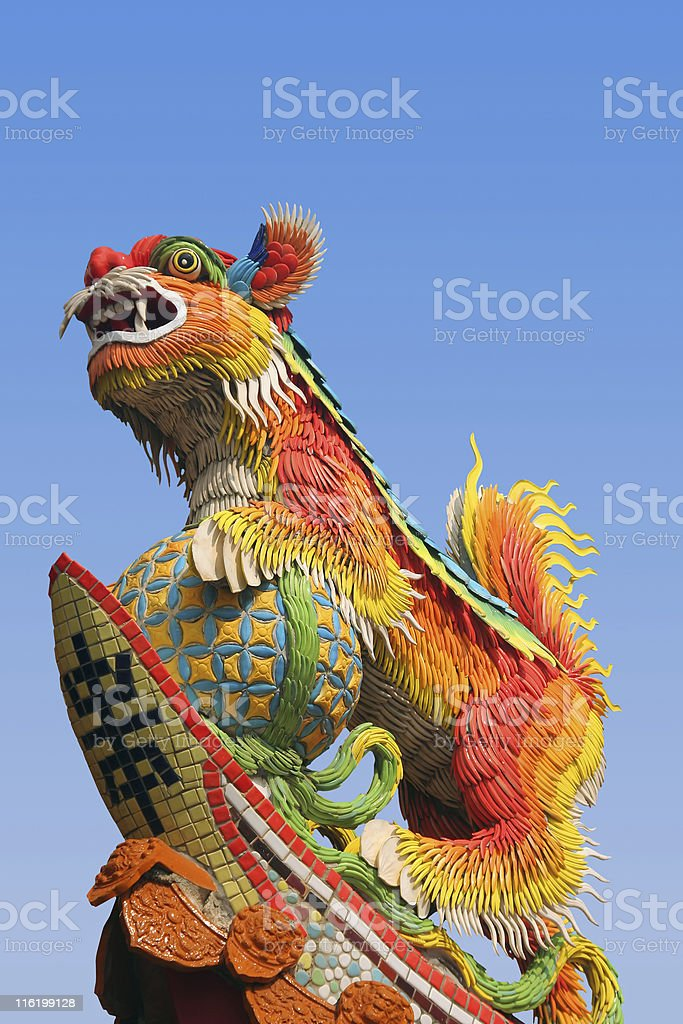 Oriental lion on temple roof stock photo