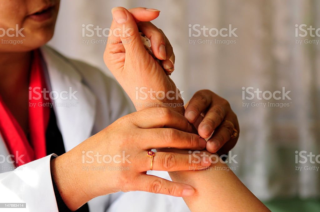 Oriental medicine doctor taking the pulse royalty-free stock photo
