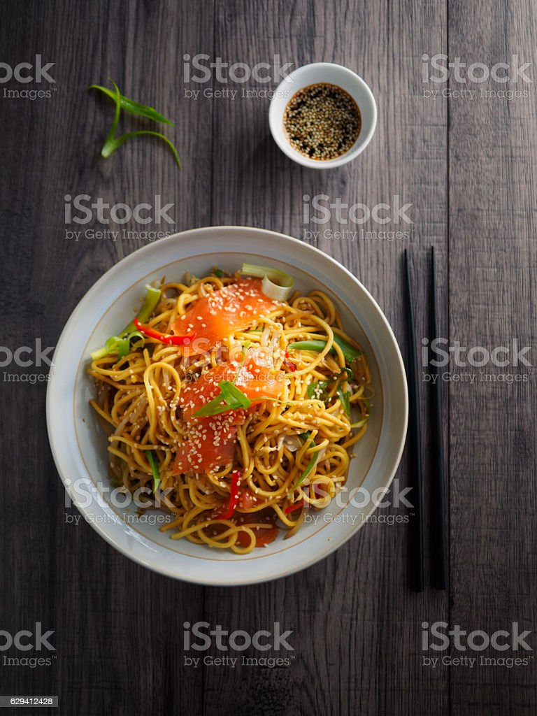 Oriental noodles salad with smoke salmon stock photo