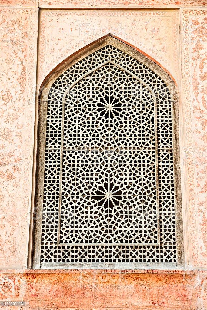 Oriental ornamented window of Ali Qapu Palace,  Iran. stock photo
