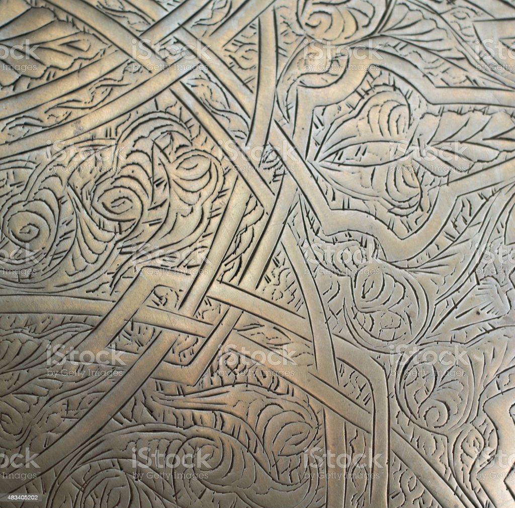 oriental pattern on the metal stock photo
