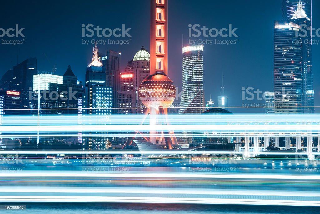 Oriental Pearl Tower with light trails from a lighted boat stock photo