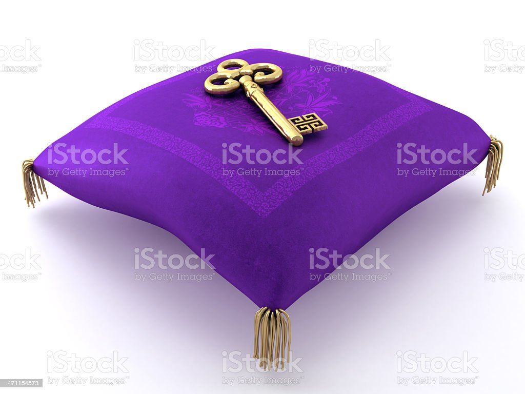 Oriental purple pillow with a gold key stock photo