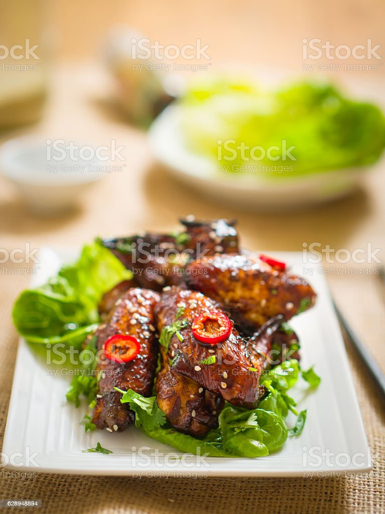 Oriental sticky chicken wings stock photo