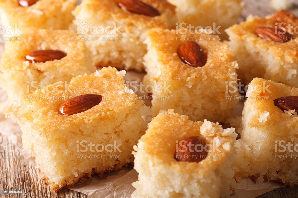 Oriental sweets: basbousa with almonds close-up. horizontal stock photo