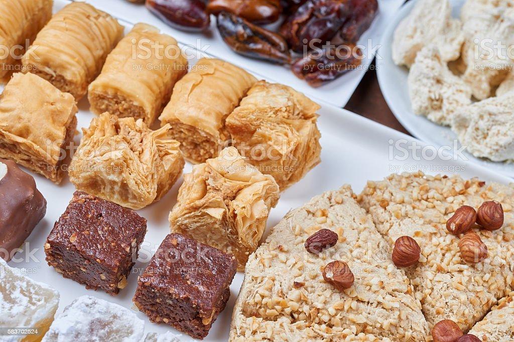 Oriental sweets on a white plate. Turkish or greek delight stock photo