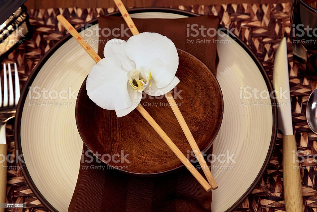 Oriental Table Setting with Orchid in neutral colors royalty-free stock photo