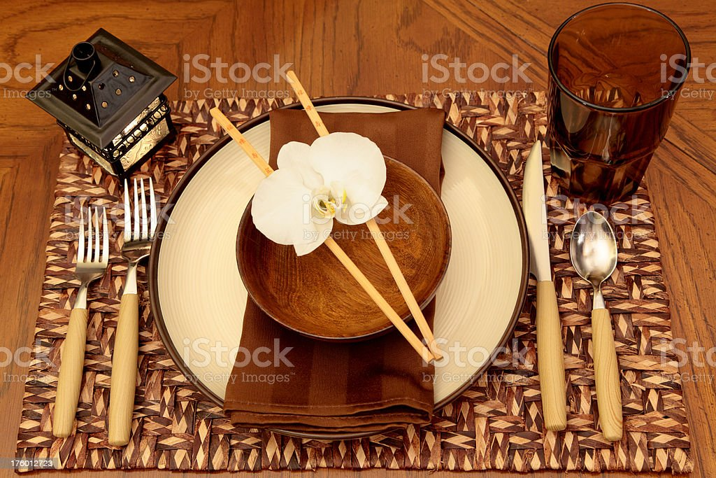 Oriental Table Setting with Orchid royalty-free stock photo