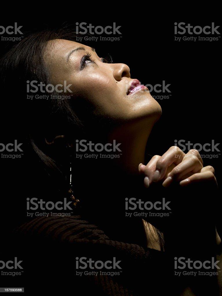Oriental woman praying royalty-free stock photo