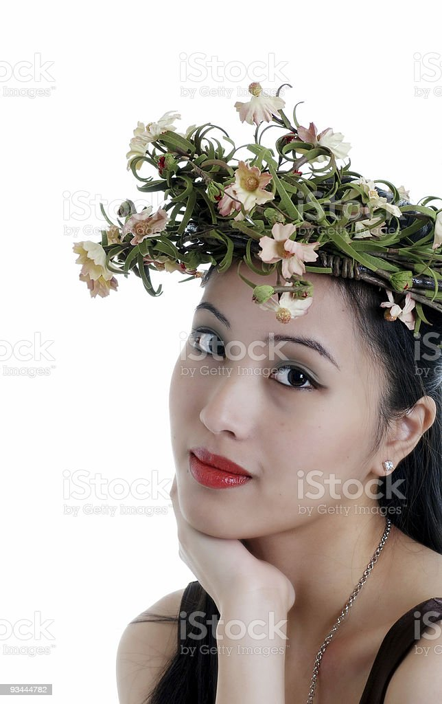 oriental woman wearing a flower crown royalty-free stock photo