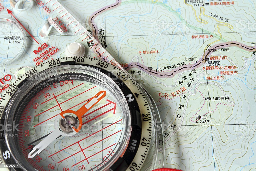 Orienteering compass on the map stock photo